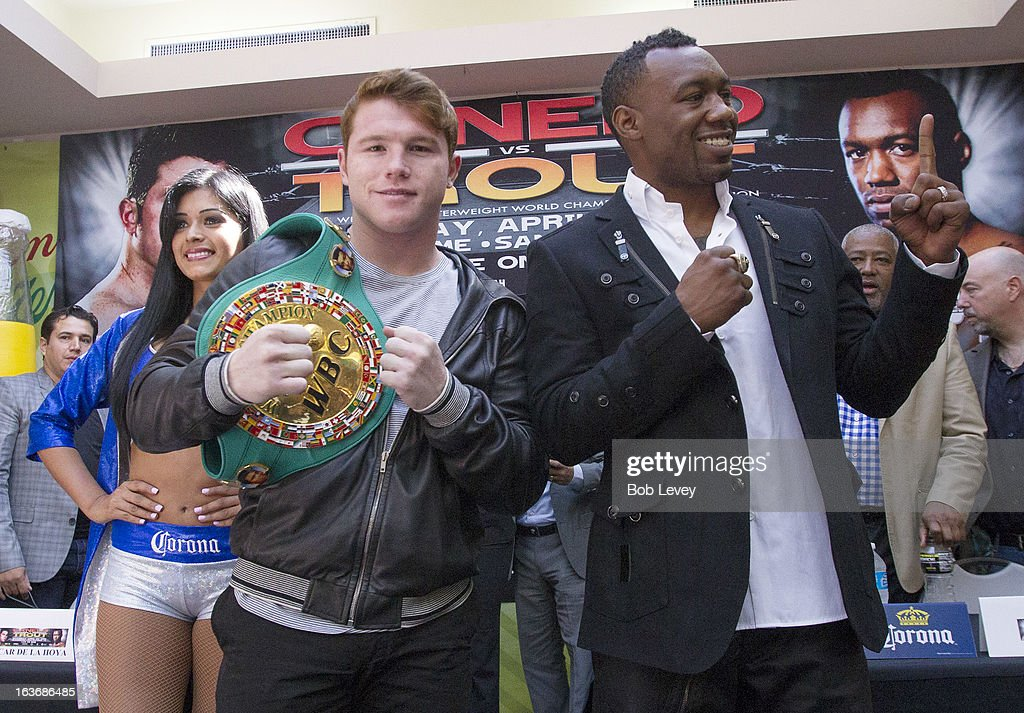 Super Welterweight Champion Canelo Alvarez (L) and WBA Super Welterweight Champion Austin 'No Doubt' Trout pose for photographers after a press conference on March 14, 2013 in Houston, Texas. Alvaez and Trout will unify the 154-pound division April 20, 2013 in San Antonio.