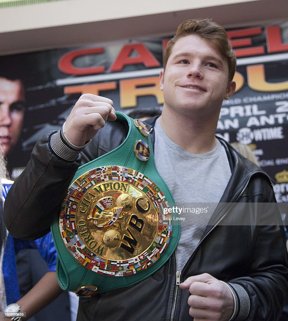 Super Welterweight Champion Canelo Alvarez listens during a press conference promoting a fight against WBA Super Welterweight Champion Austin 'No Doubt' Trout in San Antonio on April 20, during a press conference on March 14, 2013 in Houston, Texas.