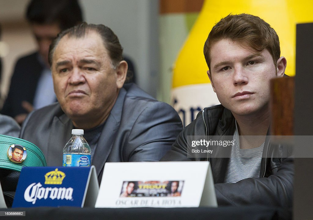 Super Welterweight Champion Canelo Alvarez (R) listens during a press conference promoting a fight against WBA Super Welterweight Champion Austin 'No Doubt' Trout in San Antonio on April 20, during a press conference on March 14, 2013 in Houston, Texas.