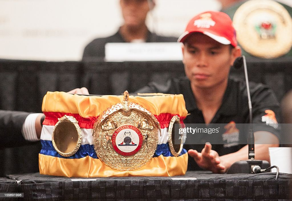 "WBA Super World Featherweight Boxing Champion Chris 'The Dragon' John displays his Championship Belt during the Dragon Fire World Championship Boxing 2012 press conference in Singapore on November 7, 2012. Indonesian superstar and current undefeated WBA Super World Featherweight Boxing Champion Chris ""The Dragon"" John returns to defend his title against the undefeated Chonlatarn Piriyapinyo from Thailand on November 9 in Singapore."