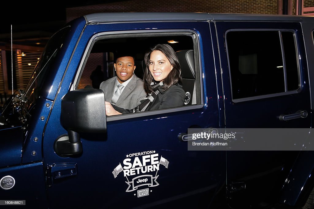 Superbowl champion Baltimore Raven Ray Rice (L) and actress Olivia Munn test drive the Jeep Wrangler Freedom Edition at the launch event for Jeep Operation Safe Return at the USO Warrior & Family Center on February 6, 2013 in Fort Belvoir, Virginia.