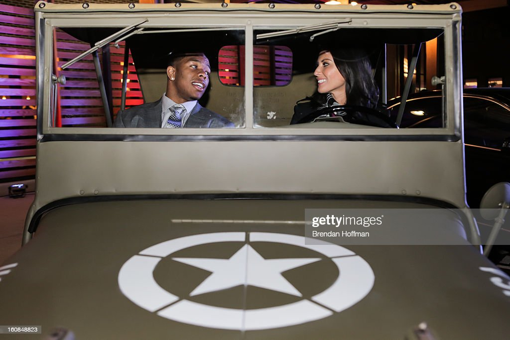 Superbowl champion Baltimore Raven Ray Rice (L) and actress Olivia Munn sit in a 1941 Willys MB at the launch event for Jeep Operation Safe Return at the USO Warrior & Family Center on February 6, 2013 in Fort Belvoir, Virginia.