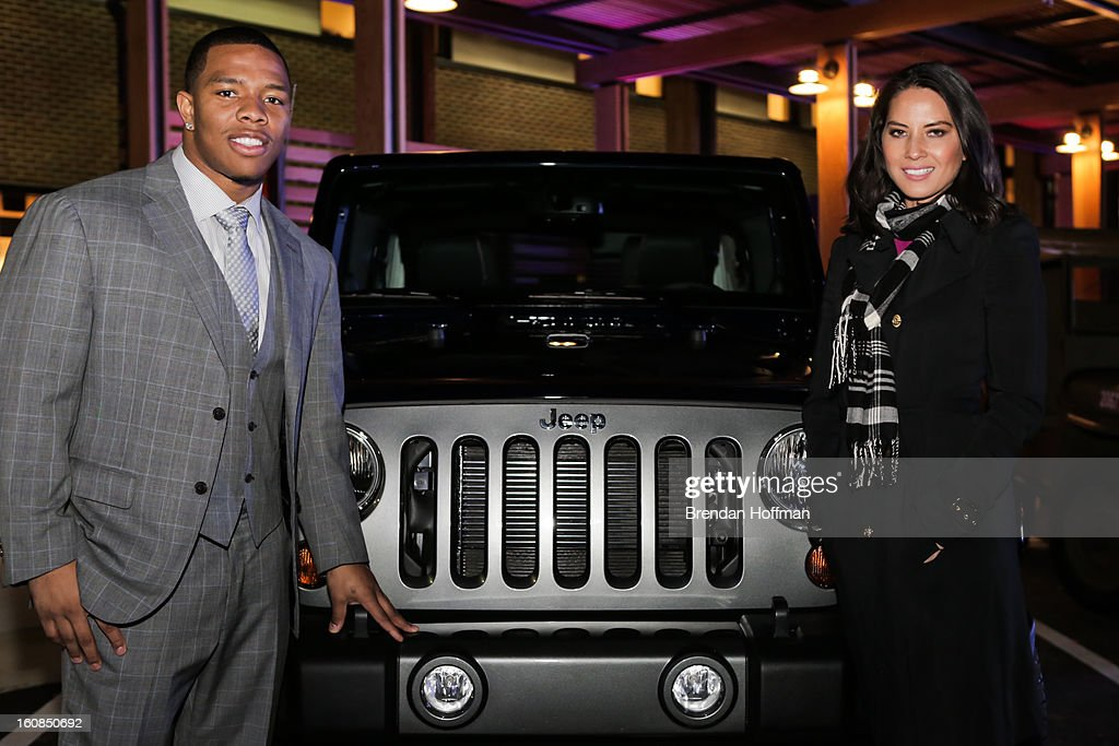 Superbowl champion Baltimore Raven <a gi-track='captionPersonalityLinkClicked' href=/galleries/search?phrase=Ray+Rice&family=editorial&specificpeople=3980395 ng-click='$event.stopPropagation()'>Ray Rice</a> (L) and actress <a gi-track='captionPersonalityLinkClicked' href=/galleries/search?phrase=Olivia+Munn&family=editorial&specificpeople=598969 ng-click='$event.stopPropagation()'>Olivia Munn</a> pose for a picture with the Jeep Wrangler Freedom Edition at the launch event for Jeep Operation Safe Return at the USO Warrior & Family Center on February 6, 2013 in Fort Belvoir, VA.