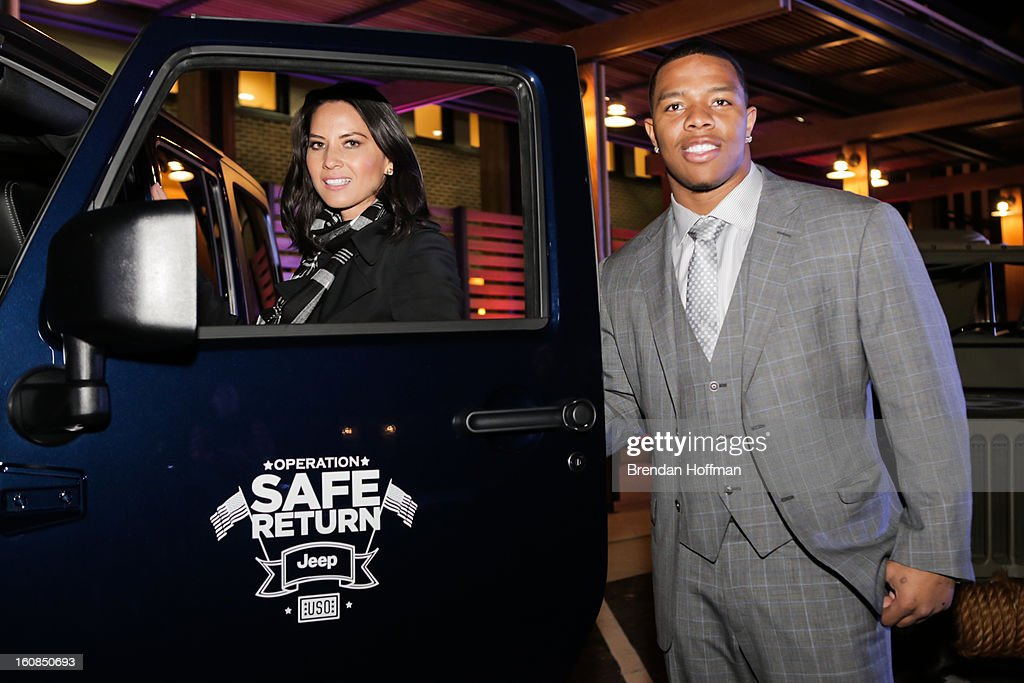 Superbowl champion Baltimore Raven Ray Rice (L) and actress Olivia Munn pose for a picture with the Jeep Wrangler Freedom Edition at the launch event for Jeep Operation Safe Return at the USO Warrior & Family Center on February 6, 2013 in Fort Belvoir, VA.