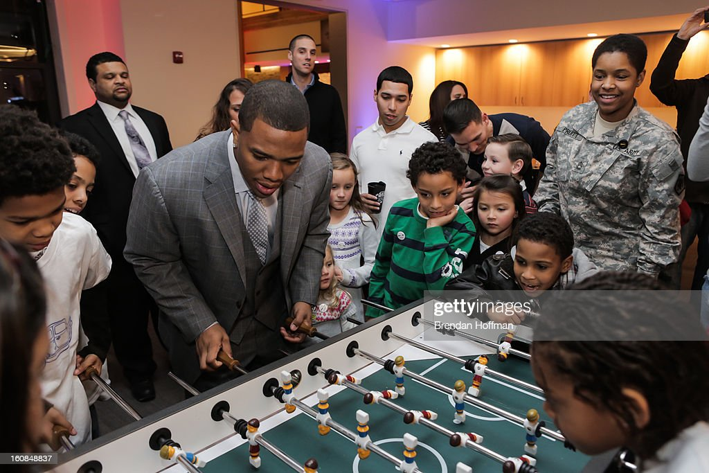 Superbowl champion Baltimore Raven Ray Rice plays foosball with military members and their families at the launch event for Jeep Operation Safe Return at the USO Warrior & Family Center on February 6, 2013 in Fort Belvoir, Virginia.
