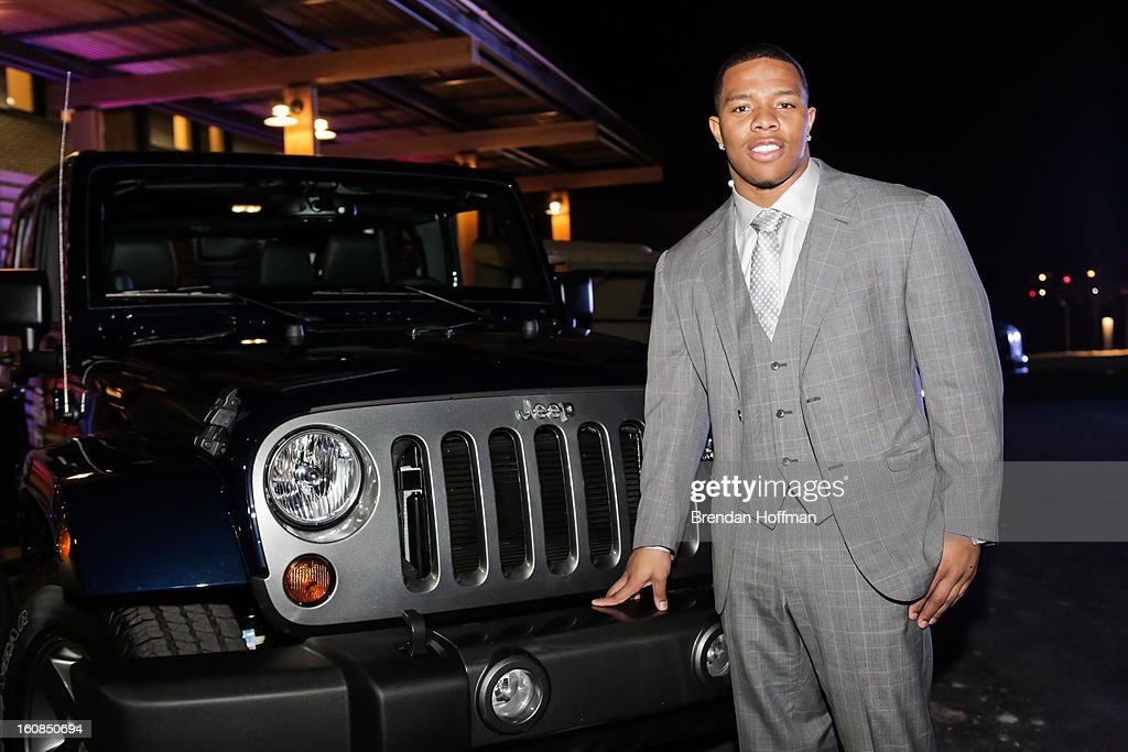 Superbowl champion Baltimore Raven <a gi-track='captionPersonalityLinkClicked' href=/galleries/search?phrase=Ray+Rice&family=editorial&specificpeople=3980395 ng-click='$event.stopPropagation()'>Ray Rice</a> poses for a picture with the Jeep Wrangler Freedom Edition at the launch event for Jeep Operation Safe Return at the USO Warrior & Family Center on February 6, 2013 in Fort Belvoir, VA.