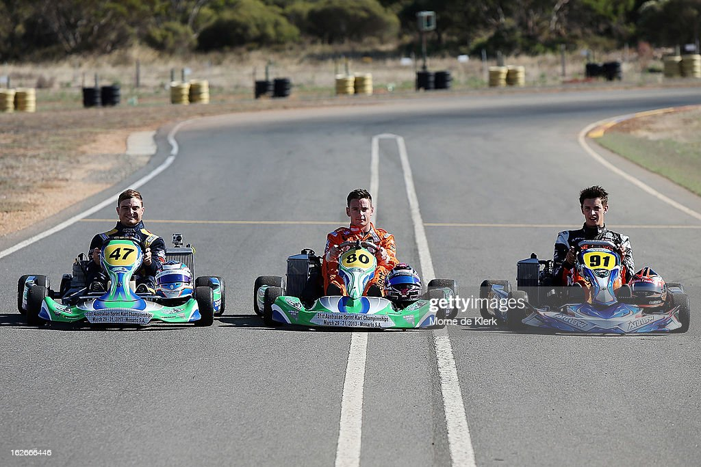 V8 Supercar drivers Tim Slade, Scott Pye and Nick Percat, who all started through Go-Karting in South Australia, pose for a photograph at the Monarto Karting Complex on February 26, 2013 in Adelaide, Australia.