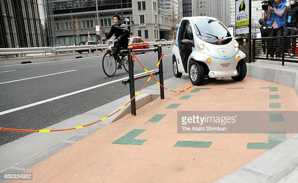A supercompact electric vehicle at a parking space as a a carsharing feasibility study starts on December 20 2016 in Tokyo Japan Futuristic oneseater...