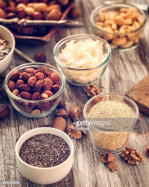 Superfoods in Bowls on Wooden Background
