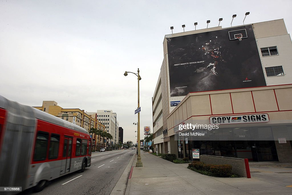 A supergraphic billboard along Wilshire Boulevard is among those at 12 locations that are at the center of a nuisance abatement lawsuit by the city in a long-running struggle to enforce outdoor advertising laws on February 26, 2010 in Los Angeles, California. Los Angeles City Attorney Carmen Trutanich is accusing 27 businesses and individuals of erecting illegal building-sized vinyl or plastic ads throughout the city. Trutanich will seek fines of up to $5,000 a day for each day for illegal supergraphic on buildings and for those freeways he will also ask for $10,000 plus $100 for each day an unpermitted sign is up. One of the defendants, World Wide Rush, is fighting the city ban against supergraphics and has a separate billboard case pending before the 9th Circuit Court of Appeals.
