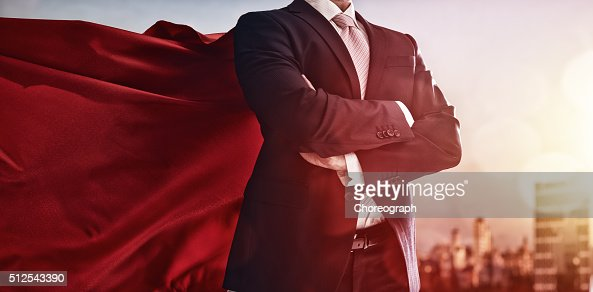 superhero businessman looking at city : Stock Photo