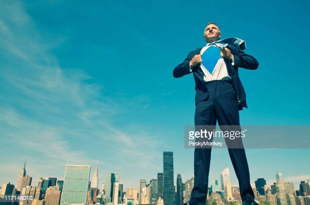 Superhero Businessman Standing Tall and Ready Above City Skyline