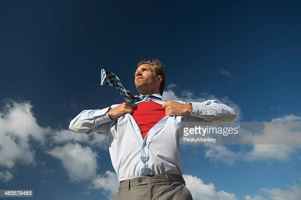 Superhero Businessman Standing with Red Shirt at Blue Sky