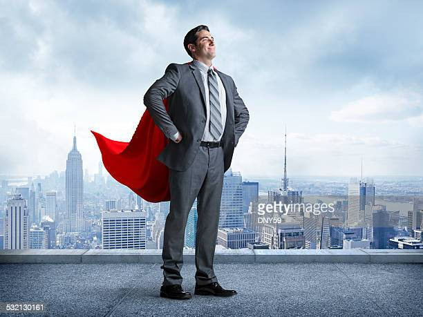 Superhero Businessman With Cityscape In The Background