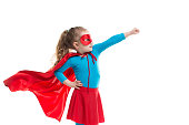 Superhero child (girl), isolated on white background.