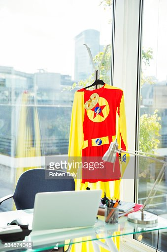 Superhero costume hanging in business office
