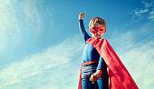 Superhero child concept for childhood, imagination and aspirations