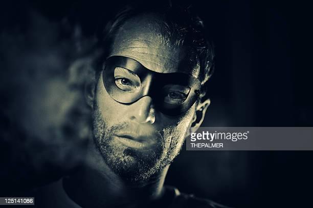 superhero smoking in the dark