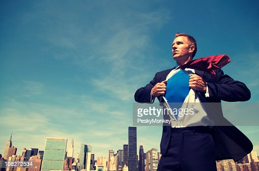 Superhero Young Man Businessman Standing Outdoors Over City Skyline : Stock Photo
