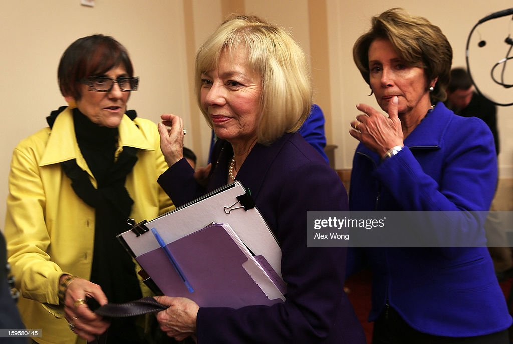 Superintendent of schools of Newtown, Connecticut, Janet Robinson (C) leaves as U.S. Rep. Rosa DeLauro (D-CT) (L) and House Minority Leader Rep. Nancy Pelosi (D-CA) look on after she testified during a hearing before the House Democratic Steering and Policy Committee January 16, 2013 on Capitol Hill in Washington, DC. The committee held a hearing to focus on gun violence prevention.