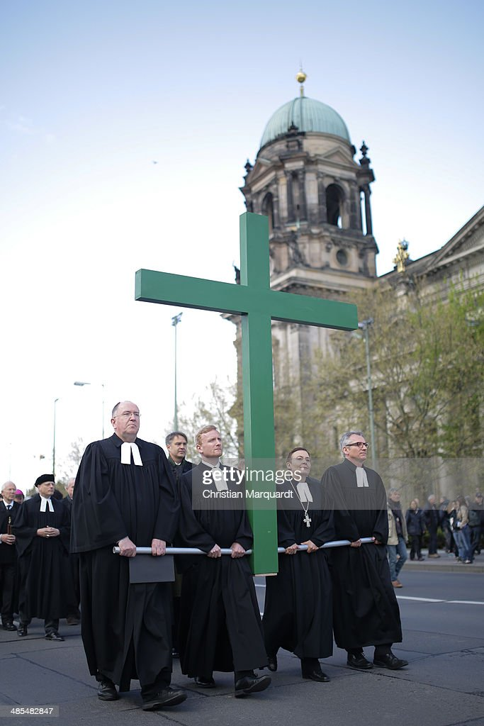 Superintendent of the Protestant church Bertold Hoecker, Cathedral preacher Michael Koesling, General superintendent of the Protestant church Ulrike Trautwein and Cathedral preacher Thomas C. Mueller carry a wooden cross during the ecumenical Good Friday procession on April 18, 2014 in Berlin Germany. Under the theme of 'Reformation and Politics' the Protestant church invites this year's politicians to join the traditional march through Berlin.