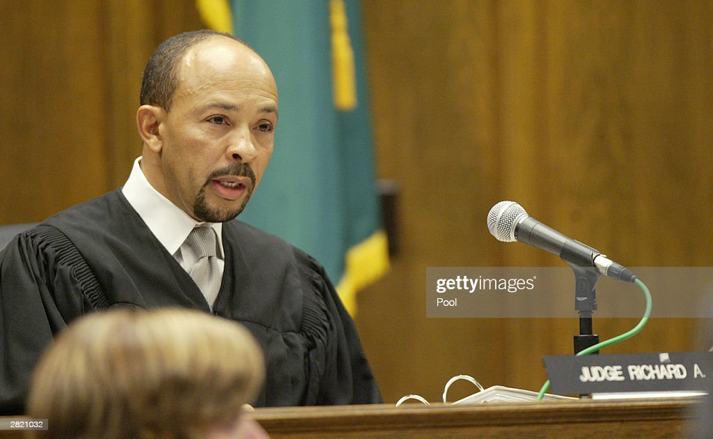 Superior Court Judge Richard A. Jones reads the sentence of life without parole to Gary Ridgway in King County Washington Superior Court December 18, 2003 in Seattle, Washington. Ridgway received 48 life sentences, with out the possibility of parole, for killing 48 women over the past 20 years in the Green River Killer serial murder case.