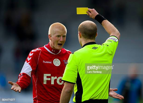 Superliga Yellow Card for Thomas Mikkelsen VB Vejle Boldklub from Referee Peter KjærsgaardAndersen Lars Rønbøg / Viasatdivisionen
