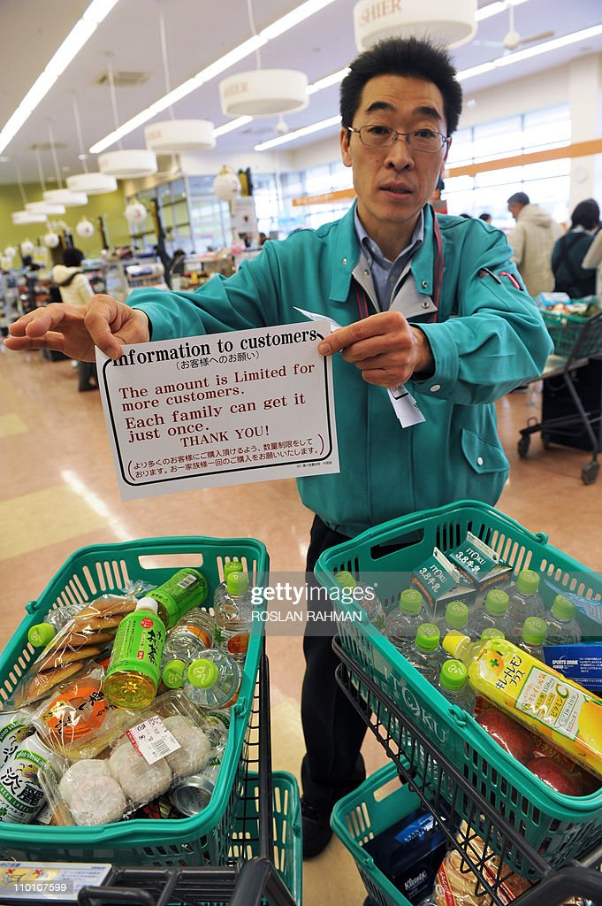 A supermarket staff member displays a notice informing customers of purchases of goods will be limited at a supermarket in the northwestern city of Akita on March 15, 2011 as panic buying sweeps the country following the March 11 earthquake and tsunami in eastern Japan as well as a nuclear crisis in Fukushima prefecture. Japan's nuclear crisis escalated on March 15 as two more blasts and a fire rocked the quake-stricken atomic power plant, sending radiation up to dangerous levels. AFP PHOTO / ROSLAN RAHMAN