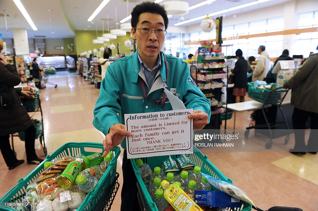 A supermarket staff member displays a notice informing customers of purchases of goods will be limited at a supermarket in the northwestern city of Akita on March 15, 2011 as panic buying sweeps the country following the March 11 earthquake and tsunami in eastern Japan as well as a nuclear crisis in Fukushima prefecture. Japan's nuclear crisis escalated on March 15 as two more blasts and a fire rocked the quake-stricken atomic power plant, sending radiation up to dangerous levels.
