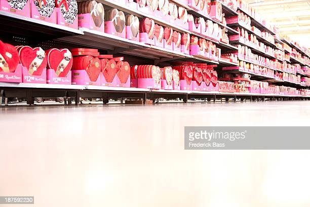 A supermarket store aisle filled with various Valentine's Day's boxes of chocolate