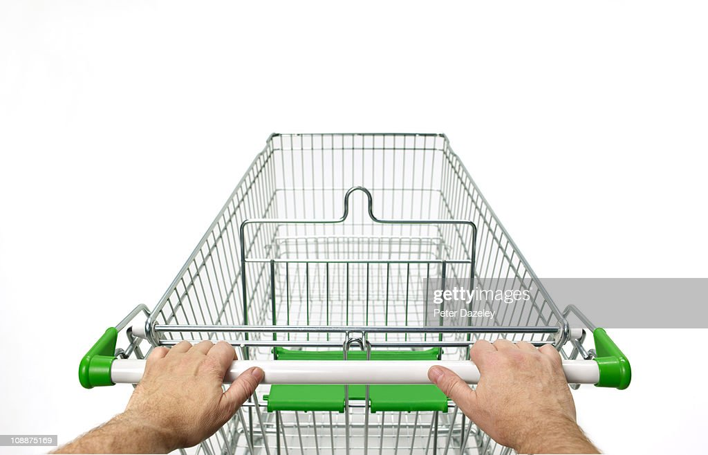 supermarket trolley with man's hands on white : Stock Photo