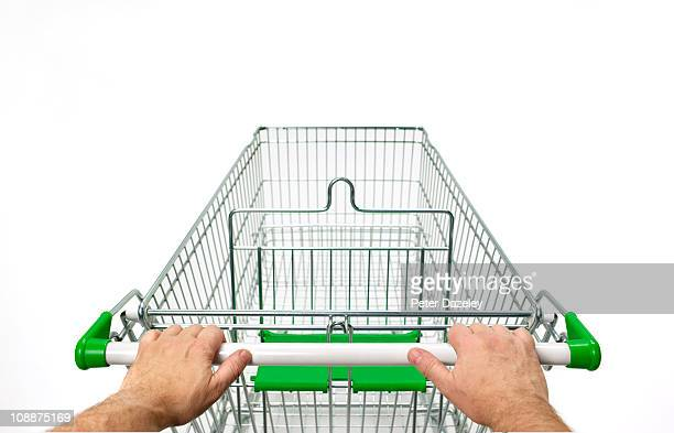 supermarket trolley with man's hands on white