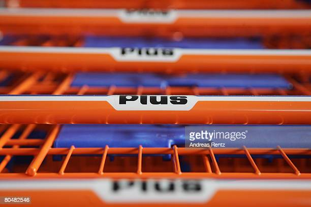 Supermarket trolleys of German discount grocery chain Plus are lined up on April 2 2008 in Berlin Germany According to an investigation by the German...