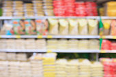supermarket with rice shelves blur background