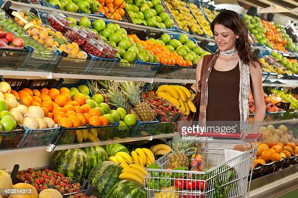 Supermarket - Woman choosing bananas