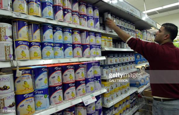 A supermarket worker organizes the baby food shelf next to Remedia products in Jerusalem 11 November 2003 The Israeli secret services have been...