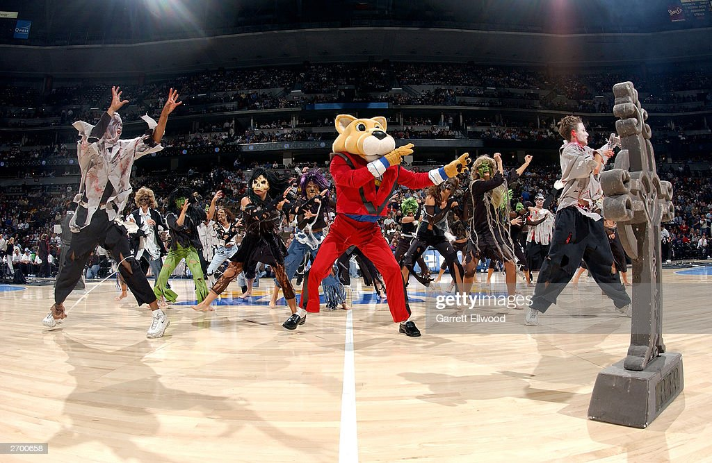 Supermascot Rocky of the Denver Nuggets dances to a Halloween themed performance at halftime of the game against the San Antonio Spurs at the Pepsi Center on October 29, 2003 in Denver, Colorado. The Nuggets won 80-72.