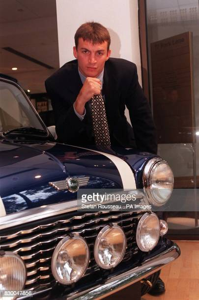 WBC SuperMiddleweight champion Richie Woodhall poses next to a MiniCooper S used in the film 'The Italian Job' during a photocall in London this...