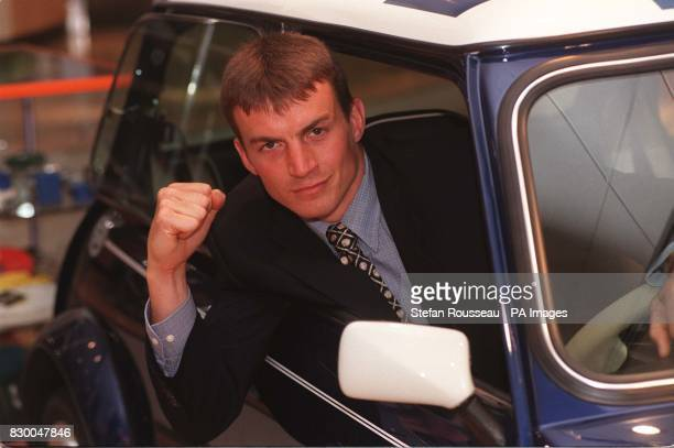 WBC SuperMiddleweight champion Richie Woodhall sits in a MiniCooper S used in the film 'The Italian Job' during a photocall in London this afternoon...