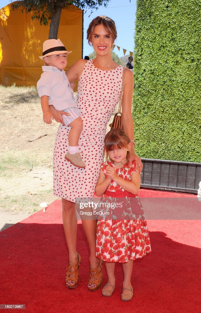 Supermodel Alessandra Ambrosio, son Noah Phoenix Ambrosio Mazur and daughter Anja Louise Ambrosio Mazur arrive at the Veuve Clicquot Polo Classic at Will Rogers State Historic Park on October 5, 2013 in Pacific Palisades, California.