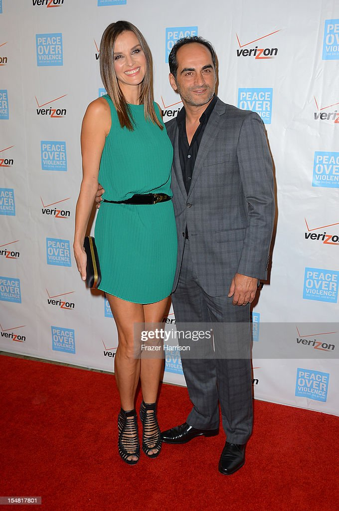 Supermodel Ana Alexander (L) and actor Navid Negahban arrive at the 41st Annual Peace Over Violence Humanitarian Awards held at Beverly Hills Hotel on October 26, 2012 in Beverly Hills, California.