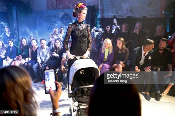 Supermodel and actress Karolina Kurkova designer Anna K Martin Pos and singer Alec Voelkel during the Cybex Fashion Cocktail on September 5 2017 in...