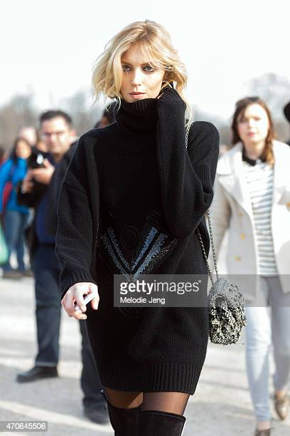 Supermodel Anja Rubik exits the Elie Saab show at the Tuileries in a Redemption Choppers sweater dress Chanel bag and Anthony Vaccarello boots on Day...