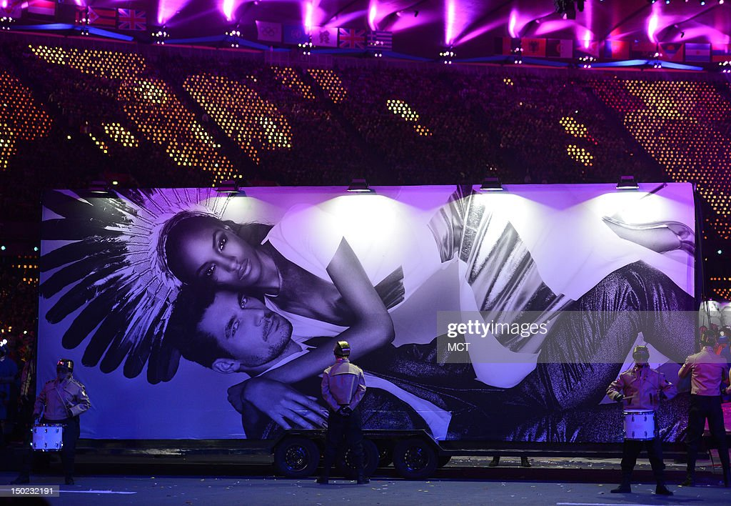 Supermodel billboards on wheels encircle the infield during the playing of David Bowie's 'Fashion' at the Olympic Stadium in London, England, during the Closing Ceremony for the London 2012 Summer Olympic Games, Sunday, August 12, 2012.