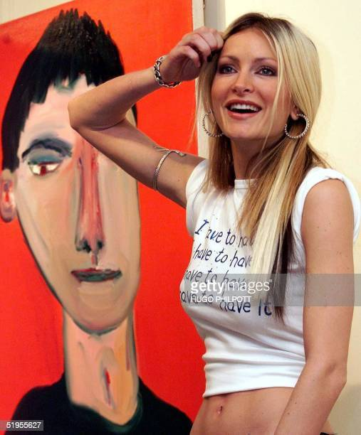 Supermodel Caprice wears a tshirt designed by artist Toby Mott with the slogan 'I have to have it' in aid of the charity 'art against addiction' at...