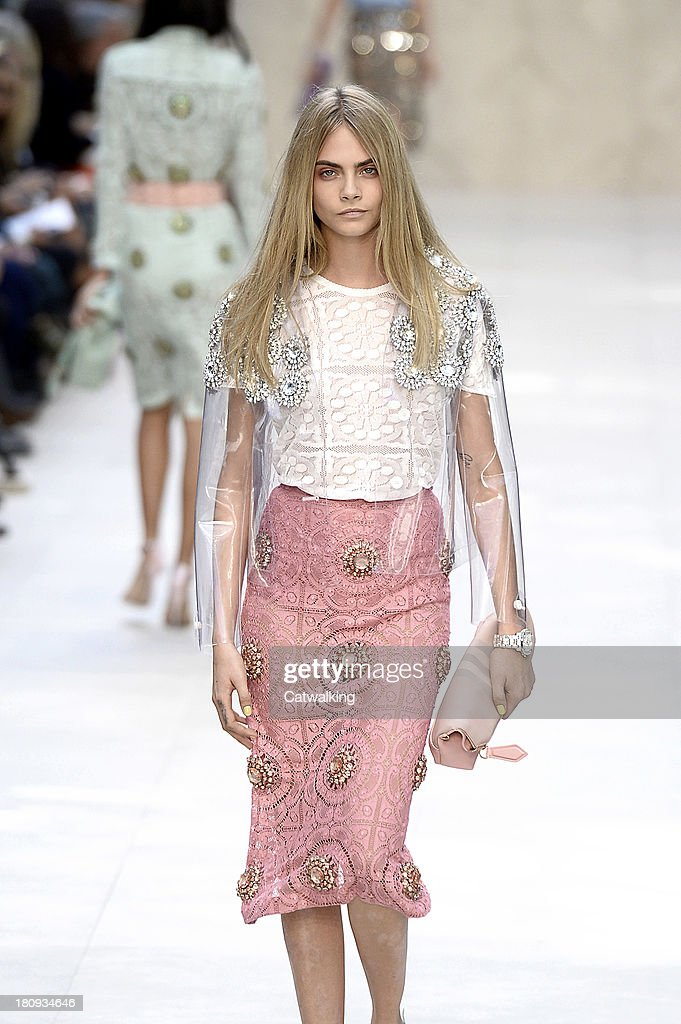 Supermodel <a gi-track='captionPersonalityLinkClicked' href=/galleries/search?phrase=Cara+Delevingne&family=editorial&specificpeople=5488432 ng-click='$event.stopPropagation()'>Cara Delevingne</a> walks the runway at the Burberry Prorsum Spring Summer 2014 fashion show during London Fashion Week on September 16, 2013 in London, United Kingdom.
