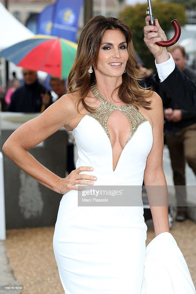 Supermodel Cindy Crawford poses as she leaves the 'Roberto Cavalli' yacht during the 66th Annual Cannes Film Festival on May 15, 2013 in Cannes, France.