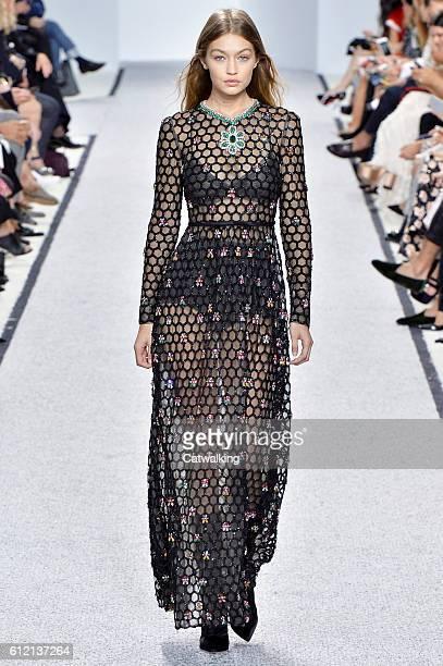 Supermodel Gigi Hadid walks the runway at the Giambattista Valli Spring Summer 2017 fashion show during Paris Fashion Week on October 3 2016 in Paris...
