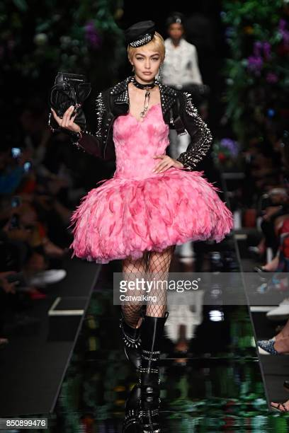 Supermodel Gigi Hadid walks the runway at the Moschino Spring Summer 2018 fashion show during Milan Fashion Week on September 21 2017 in Milan Italy