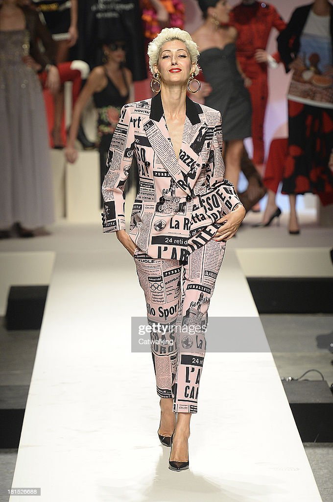Supermodel Gisele walks the runway at the Moschino anniversary event and Spring Spring Summer 2014 fashion show during Milan Fashion Week on September 21, 2013 in Milan, Italy.